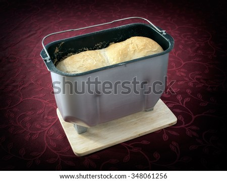 Bread in the bold after baking in automatic bread making machine. - stock photo