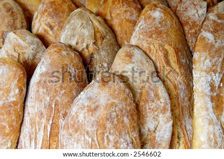 """Bread is a staple food in France. The typical loaf of French bread is called """"une baguette"""", which means stick or wand. - stock photo"""