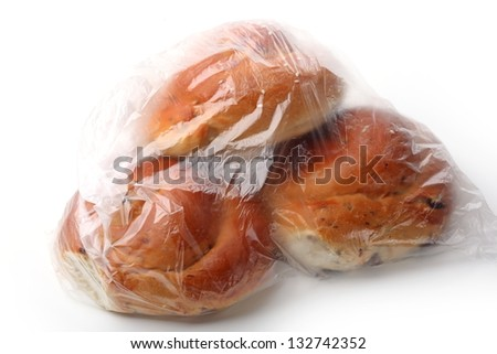Bread loaf in the plastic bag isolated on white background