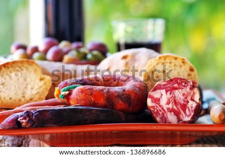 Bread, meat of pork and portuguese wine - stock photo