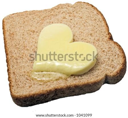Bread melts butter heart - stock photo