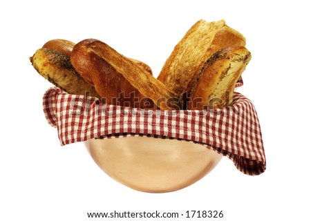 bread on a red and white checkered napkin in a copper bowl - stock photo