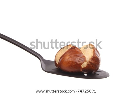 Bread on a spoon against a white background