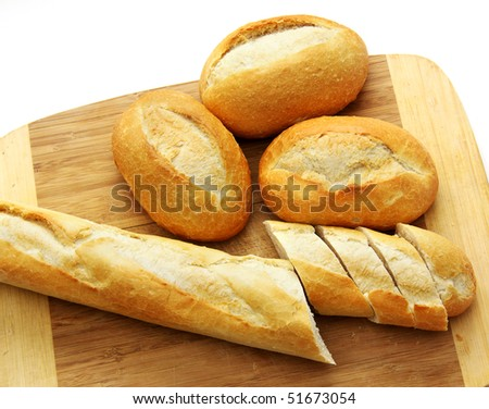 Bread on a wooden board, on a white background