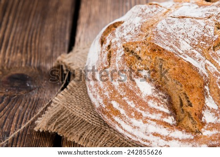 Bread on dark rustic wooden background as detailed close-up shot - stock photo