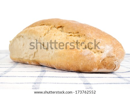 bread on tablecloth - stock photo