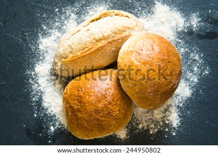 Bread, Rolls And Flour On Black Chalkboard - stock photo