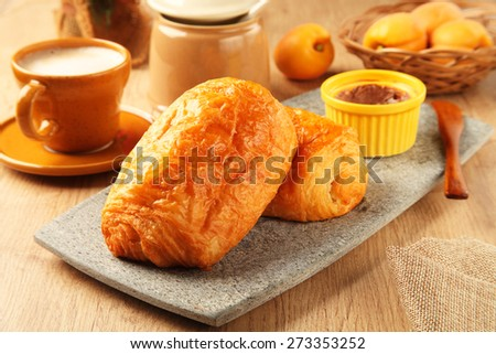 Bread rolls on the stone plate - stock photo