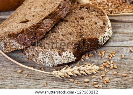 Bread rye spikelets on an old background