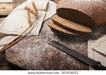 Bread rye spikelets on an wooden background