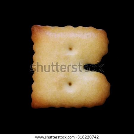 Bread sample letter B on black background. - stock photo