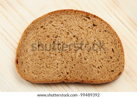 Bread slice on wooden table