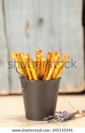 Bread Sticks in bucket with lavender - stock photo