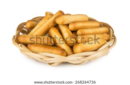 Bread sticks with salt in wicker basket isolated on white background - stock photo