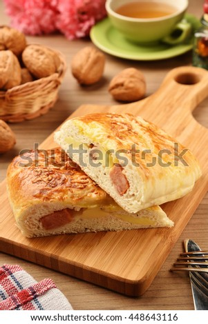 Bread stuffed with sausage and cheese  on a cutting board