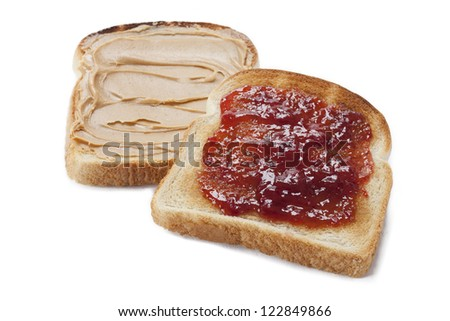 Bread toast with peanut butter and jam displayed on white background. - stock photo