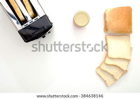 bread toaster and toasted bread and jam - stock photo
