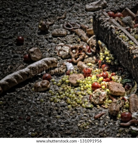 Bread, tomatoes and grapes as hogwash/Artistically alienated to create a grungy somber atmosphere. - stock photo