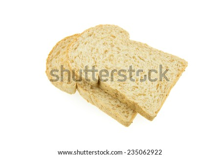 Bread - two sliced original whole wheat loaf on white background - stock photo