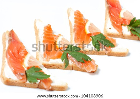 Bread with butter and salmon.