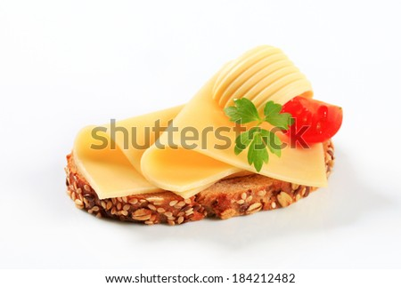 Bread with butter and sliced cheese - stock photo