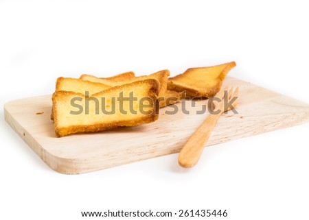 Bread with butter on wooden white background