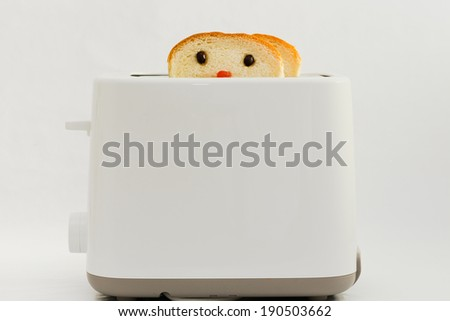 Bread with Cute Face  Decorated by coffee bean as the eyes and strawberry jam as nose  Baking in Toaster - stock photo