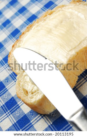 Bread with delicious thick buttered spread over it - stock photo