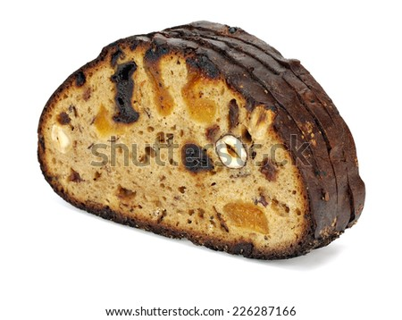 Bread with nuts and dried fruits on a white background - stock photo