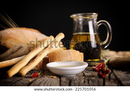 Bread with olive oil and balsamic vinegar dip - stock photo