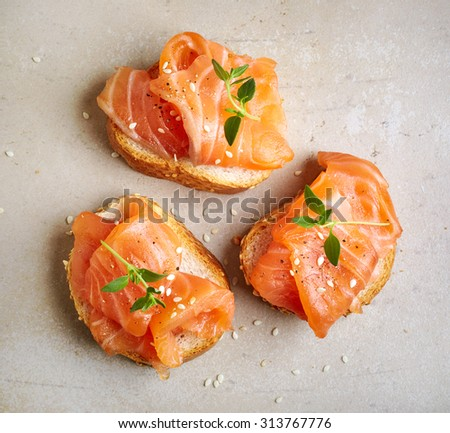 bread with salmon fillet, top view - stock photo