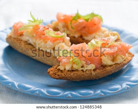Bread with scrambled egg and salmon, selective focus
