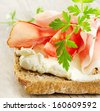 Bread with smoked bacon and cream cheese . Selective focus - stock photo
