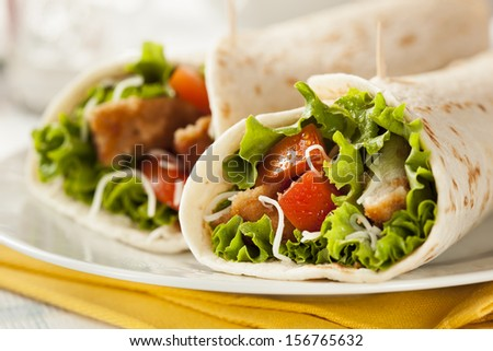 Breaded Chicken in a Tortilla Wrap with Lettuce and Tomato