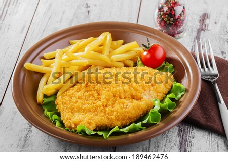 breaded chicken schnitzel fries - stock photo