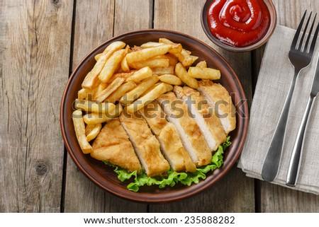 breaded chicken schnitzel with potatoes - stock photo