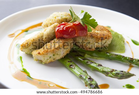 Breaded chicken with asparagus