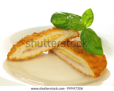 Breaded cutlet served on a plate on isolated background - stock photo