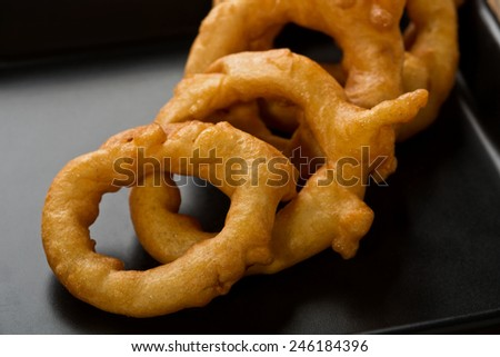 breaded deep fried onion rings - stock photo