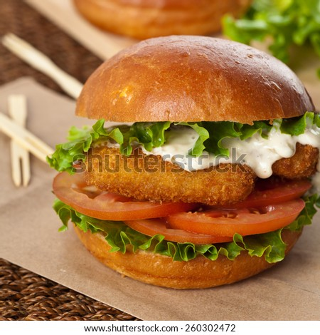 Breaded Fish burger. Selective focus. - stock photo