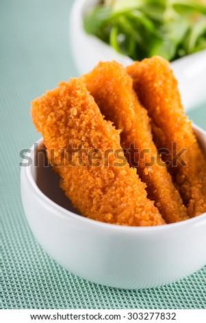 breaded fish sticks - stock photo