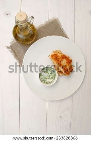 Breaded fried fish cutlets with yogurt  dip - stock photo