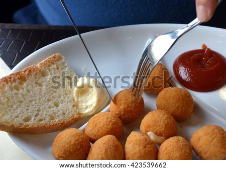 Breaded mozzarella cheese balls, arancine