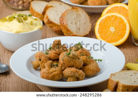 Breaded mushrooms fried with fresh orange juice and homemade tartar sauce