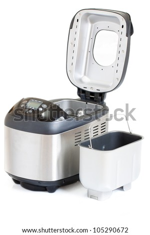 Breadmaker machine and accessories isolated on a white background - stock photo