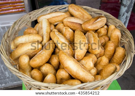 Breads in basket for sale at the street market in Vietnam