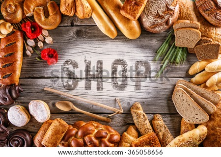 breads, pastries, christmas cake on wooden background with letters, picture for bakery or shop - stock photo