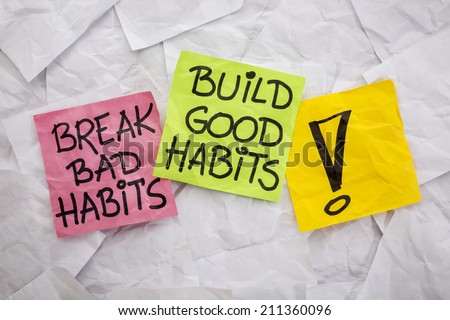 break bad habits, build good habits - motivational reminder on colorful sticky notes - self-development concept - stock photo