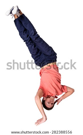 Break dancer doing an one handed handstand against a white background