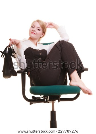 Break from work. Young businesswoman happy girl with shoes in hand relaxing on chair isolated on white. Copy space. Business.